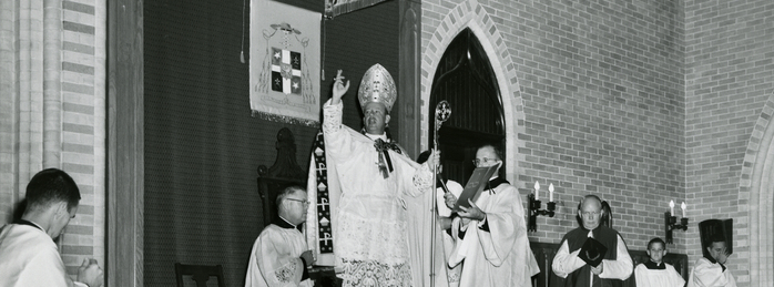 Bishop Tracy blesses the congregation upon his installation as Baton Rouge's First Bishop, 1961.